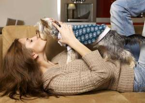 woman-kissing-terrier-couch_0
